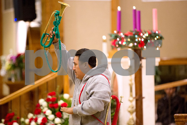 A man leads a group of trumpeters at Día de la Virgen de Guadalupe feast day and mass, celebrated at St. Peter Claver Parish in Tyler, Texas, on Tuesday, Dec. 12, 2017. Día de la Virgen de Guadalupe honors the belief that Jesus' mother Mary, Mexico's patron saint, appeared to Juan Diego in Mexico City in 1531. (Chelsea Purgahn/Tyler Morning Telegraph)