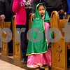 A young girl is dressed as Our Lady of Guadalupe at Día de la Virgen de Guadalupe feast day and mass, celebrated at St. Peter Claver Parish in Tyler, Texas, on Tuesday, Dec. 12, 2017. Día de la Virgen de Guadalupe honors the belief that Jesus' mother Mary, Mexico's patron saint, appeared to Juan Diego in Mexico City in 1531. (Chelsea Purgahn/Tyler Morning Telegraph)