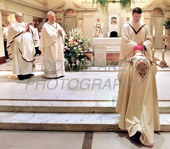 Michael Darcy blesses Bishop Michael Saltarelli as Cornelius Breslin and Richard Smith watch after being ordained during the ordination mass at the Cathedral St. Peter in Wilmington Saturday May 27, 2000.photo/Don Blake