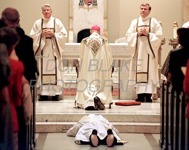 Michael Darcy lies prostrate to signify his Christ like sacrifice and obedience during the ordination mass at the Cathedral St. Peter in Wilmington Saturday May 27, 2000.photo/Don Blake