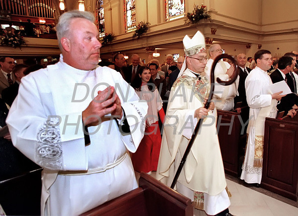 Cornelius Breslin watches as Bishop Michael Saltarelli walks to the alter during the ordination mass at the Cathedral St. Peter in Wilmington Saturday May 27, 2000.photo/Don Blake