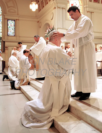 Cornelius Breslin is blessed by a fellow priest during the ordination mass at the Cathedral of St. Peter in Wilmington.photo/Don Blake