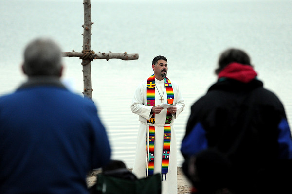 """Rev. Marty Lettow of Shepherd of the Hills Lutheran Church, speaks to the crowd on the beach.<br /> Easter Sunrise Service was held at the Boulder Reservoir by Trinity Lutheran Church and Shepherd of the Hills Lutheran Church, both of Boulder.<br /> For more photos and a video of the service, go to  <a href=""""http://www.dailycamera.com"""">http://www.dailycamera.com</a>.<br /> Cliff Grassmick/ April 24, 2011"""