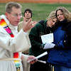 "Jennifer Angell, left, and her mother, Cindy, listen to Rev. Mark Twietmeyer during the service.<br /> Easter Sunrise Service was held at the Boulder Reservoir by Trinity Lutheran Church and Shepherd of the Hills Lutheran Church, both of Boulder.<br /> For more photos and a video of the service, go to  <a href=""http://www.dailycamera.com"">http://www.dailycamera.com</a>.<br /> Cliff Grassmick/ April 24, 2011"