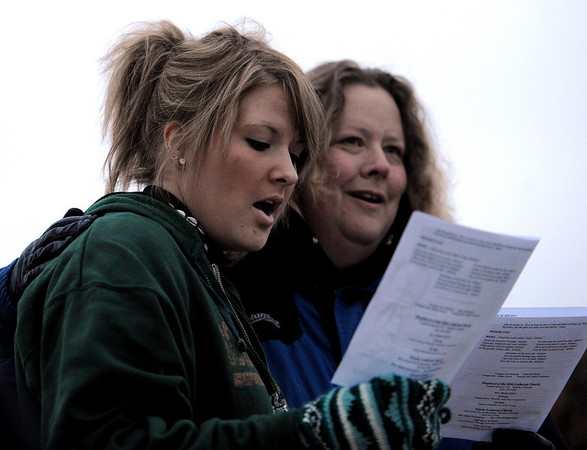 "Jennifer Angell, left, and her mother, Cindy, sing hymns during the service.<br /> Easter Sunrise Service was held at the Boulder Reservoir by Trinity Lutheran Church and Shepherd of the Hills Lutheran Church, both of Boulder.<br /> For more photos and a video of the service, go to  <a href=""http://www.dailycamera.com"">http://www.dailycamera.com</a>.<br /> Cliff Grassmick/ April 24, 2011"
