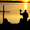 """Rev. Mark Twietmeyer, of Trinity Lutheran Church of Boulder, begins the Easter service as the sun rises over the Boulder Reservoir.<br /> Trinity Lutheran Church in Boulder and Shepherd of the Hills Lutheran Church in Gunbarrel held an Easter  sunrise service at the Boulder Reservoir for the 17th year.<br /> For a video and more photos of the Easter service, go to  <a href=""""http://www.dailycamera.com"""">http://www.dailycamera.com</a> or  <a href=""""http://www.coloradodaily.com"""">http://www.coloradodaily.com</a>.<br /> Cliff Grassmick / April 8, 2012"""
