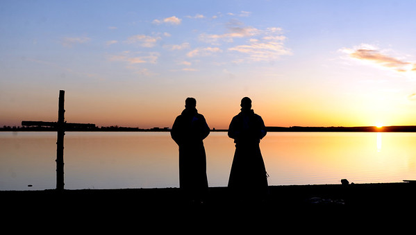 "Rev. Mark Twietmeyer, left,  of Trinity Lutheran Church of Boulder, and Martin Lettow, of Shepherd of the Hills Lutheran Church, listen to service music as the sun comes up over Boulder Reservoir.<br /> Trinity Lutheran Church in Boulder and Shepherd of the Hills Lutheran Church in Gunbarrel held an Easter  sunrise service at the Boulder Reservoir for the 17th year.<br /> For a video and more photos of the Easter service, go to  <a href=""http://www.dailycamera.com"">http://www.dailycamera.com</a> or  <a href=""http://www.coloradodaily.com"">http://www.coloradodaily.com</a>.<br /> Cliff Grassmick / April 8, 2012"