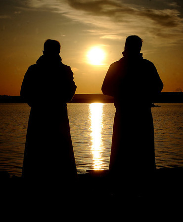 """Rev. Mark Twietmeyer, left,  of Trinity Lutheran Church of Boulder, and Martin Lettow, of Shepherd of the Hills Lutheran Church, listen to service music as the sun comes up over Boulder Reservoir.<br /> Trinity Lutheran Church in Boulder and Shepherd of the Hills Lutheran Church in Gunbarrel held an Easter  sunrise service at the Boulder Reservoir for the 17th year.<br /> For a video and more photos of the Easter service, go to  <a href=""""http://www.dailycamera.com"""">http://www.dailycamera.com</a> or  <a href=""""http://www.coloradodaily.com"""">http://www.coloradodaily.com</a>.<br /> Cliff Grassmick / April 8, 2012"""