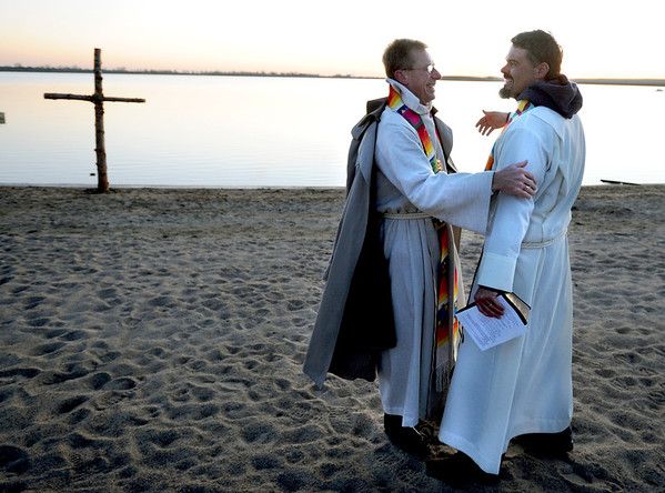 "Rev. Mark Twietmeyer, left,  of Trinity Lutheran Church of Boulder, and Martin Lettow, of Shepherd of the Hills Lutheran Church,  greet each other before the Easter service.<br /> Trinity Lutheran Church in Boulder and Shepherd of the Hills Lutheran Church in Gunbarrel held an Easter  sunrise service at the Boulder Reservoir for the 17th year.<br /> For a video and more photos of the Easter service, go to  <a href=""http://www.dailycamera.com"">http://www.dailycamera.com</a> or  <a href=""http://www.coloradodaily.com"">http://www.coloradodaily.com</a>.<br /> Cliff Grassmick / April 8, 2012"