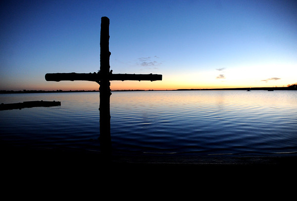 """The cross at the Boulder Reservoir awaits the sunrise.<br /> Trinity Lutheran Church in Boulder and Shepherd of the Hills Lutheran Church in Gunbarrel held an Easter  sunrise service at the Boulder Reservoir for the 17th year.<br /> For a video and more photos of the Easter service, go to  <a href=""""http://www.dailycamera.com"""">http://www.dailycamera.com</a> or  <a href=""""http://www.coloradodaily.com"""">http://www.coloradodaily.com</a>.<br /> Cliff Grassmick / April 8, 2012"""