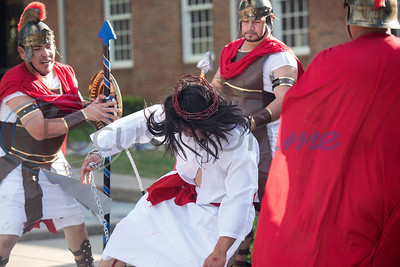 Roman soldiers beat Jesus after placing a crown of thorns on his head during a Stations of the Cross re-enactment held in Spanish on the lawn of St. Gregory Cathedral School presented by the Cathedral of the Immaculate Conception in Tyler on Good Friday, April 19, 2019. Emmanuel Ruiz of Tyler portrayed Jesus in the event. The stations tell the story of Pontius Pilate condemns Jesus to death, continuing with Jesus carrying his cross, seeing his mother, falling with his cross, being nailed to it, dying and being placed in the grave. On Sunday Christians will celebrate the resurrection of Jesus with Easter.   (Sarah A. Miller/Tyler Morning Telegraph)