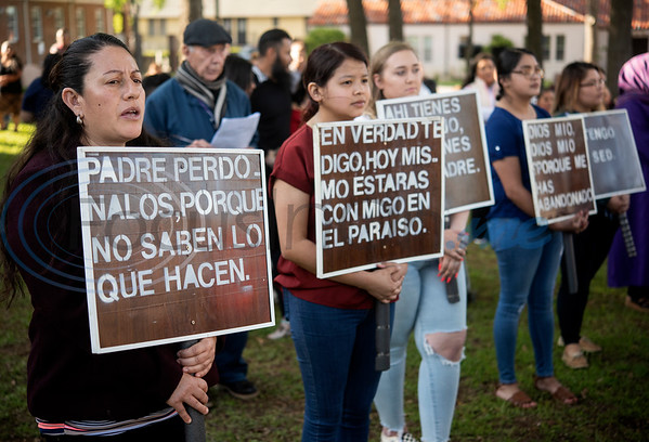 Women carry signs during a Stations of the Cross re-enactment held in Spanish on the lawn of St. Gregory Cathedral School presented by the Cathedral of the Immaculate Conception in Tyler on Good Friday, April 19, 2019. Emmanuel Ruiz of Tyler portrayed Jesus in the event. The stations tell the story of Pontius Pilate condemns Jesus to death, continuing with Jesus carrying his cross, seeing his mother, falling with his cross, being nailed to it, dying and being placed in the grave. On Sunday Christians will celebrate the resurrection of Jesus with Easter.   (Sarah A. Miller/Tyler Morning Telegraph)