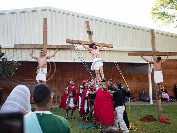 Jesus, center, is crucified with two others during a Stations of the Cross re-enactment held in Spanish on the lawn of St. Gregory Cathedral School presented by the Cathedral of the Immaculate Conception in Tyler on Good Friday, April 19, 2019. Emmanuel Ruiz of Tyler portrayed Jesus in the event. The stations tell the story of Pontius Pilate condemns Jesus to death, continuing with Jesus carrying his cross, seeing his mother, falling with his cross, being nailed to it, dying and being placed in the grave. On Sunday Christians will celebrate the resurrection of Jesus with Easter.   (Sarah A. Miller/Tyler Morning Telegraph)