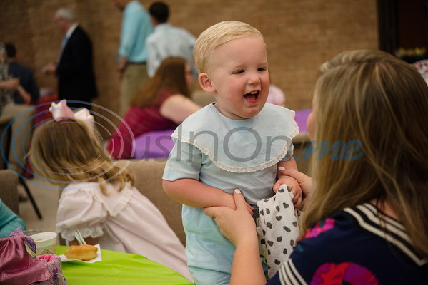 Nicole Robbins of Tyler holds up her son Whitman, 2, as they eat breakfast during the Family Easter Celebration and Butterfly Release held at Marvin United Methodist Church in downtown Tyler on Sunday April 21, 2019.   (Sarah A. Miller/Tyler Morning Telegraph)