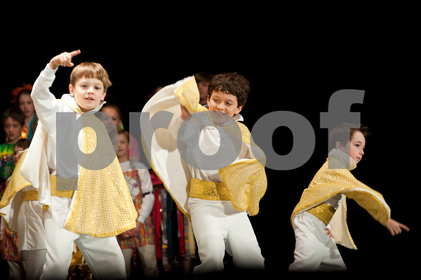 photo by Sarah A. Miller/Tyler Morning Telegraph  Boys dressed as Elvis dance on stage at St. Gregory Cathedral School's annual All School Musical Review at Caldwell Auditorium Thursday. This year's musical was called Kaleidoscope, and featured a colorful array of costumes, songs and choreography.  Students from pre-kindergarten through fifth grade participated.