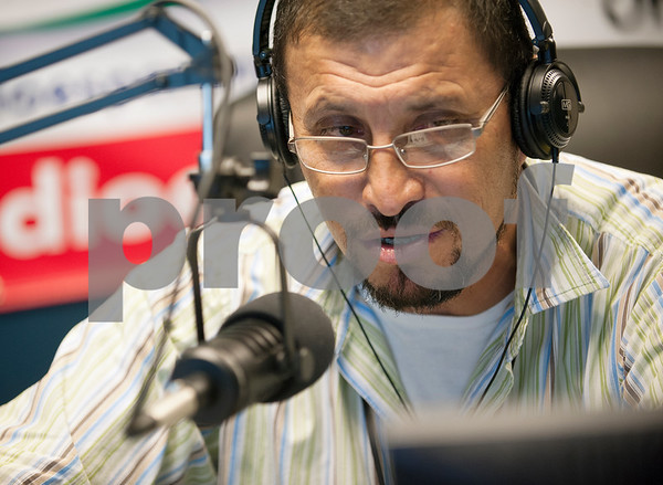 Pastor Pedro Garcia talks on Radio Esperanza between songs Wednesday July 29, 2015. Radio Esperanza is a Spanish language station that plays Christian music and is housed inside Iglesia de Dios Pentecostal, 5736 Linwood Street in Tyler.  (photo by Sarah A. Miller/Tyler Morning Telegraph)