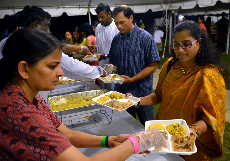 Food is served during the the Philadelphia Ganesh Festival at Bharatiya Temple in Montgomery Township on Friday September 10,2013. Photo by Mark C Psoras