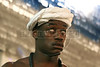 "A participant invokes a spirit, or Orixa, during a Candomble ceremony in Rio de Janeiro's working-class district of Bangu, July 24, 2005. Derived from the Yoruba people of West Africa, who were brought to the New World during the African Slave Trade, Candomble seeks harmony with nature. In fact, many Yoruba priests chose to be captured and sold into slavery so that Africans would have spiritual support in the New World. Candomble worships a number of gods or spirits, derived from African deities, known as Orix‡s. An Orixa is a spirit that reflects one of the manifestations of Olodumare (God). Orixas include Shango, Olokun, Elegua, If‡, Osun, Obatala, Ogun, Oko, Soponna, Oya and Esu, among countless others. Over the centuries Candomble has also incorporated many elements from Christianity and African deities were often identified with specific Catholic saints, in part to mask the illegal religion. In the ceremony, led by the mother-of-saint, each child-of-saint (medianic priest) invokes and ""incorporates"" an Orixa, falling into a trance-like state. After recovering from the trance, the priest-spirit performs a dance symbolic of the Orix‡'s attributes, while the father-of-saint (leading male priest) sings about the spirit's deeds.(Australfoto/Douglas Engle)"