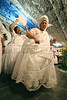 "The mother-of-saint is fanned as she dances through the decorated temple during a Candomble ceremony in Rio de Janeiro's working-class district of Bangu, July 24, 2005. Derived from the Yoruba people of West Africa, who were brought to the New World during the African Slave Trade, Candomble seeks harmony with nature. In fact, many Yoruba priests chose to be captured and sold into slavery so that Africans would have spiritual support in the New World. Candomble worships a number of gods or spirits, derived from African deities, known as Orix‡s. An Orixa is a spirit that reflects one of the manifestations of Olodumare (God). Orixas include Shango, Olokun, Elegua, If‡, Osun, Obatala, Ogun, Oko, Soponna, Oya and Esu, among countless others. Over the centuries Candomble has also incorporated many elements from Christianity and African deities were often identified with specific Catholic saints, in part to mask the illegal religion. In the ceremony, led by the mother-of-saint, each child-of-saint (medianic priest) invokes and ""incorporates"" an Orixa, falling into a trance-like state. After recovering from the trance, the priest-spirit performs a dance symbolic of the Orix‡'s attributes, while the father-of-saint (leading male priest) sings about the spirit's deeds.(Australfoto/Douglas Engle)"