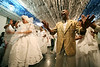 "The mother-of-saint, left dances through the decorated temple as a father-of-saint, right sings during a Candomble ceremony in Rio de Janeiro's working-class district of Bangu, July 24, 2005. Derived from the Yoruba people of West Africa, who were brought to the New World during the African Slave Trade, Candomble seeks harmony with nature. In fact, many Yoruba priests chose to be captured and sold into slavery so that Africans would have spiritual support in the New World. Candomble worships a number of gods or spirits, derived from African deities, known as Orix‡s. An Orixa is a spirit that reflects one of the manifestations of Olodumare (God). Orixas include Shango, Olokun, Elegua, If‡, Osun, Obatala, Ogun, Oko, Soponna, Oya and Esu, among countless others. Over the centuries Candomble has also incorporated many elements from Christianity and African deities were often identified with specific Catholic saints, in part to mask the illegal religion. In the ceremony, led by the mother-of-saint, each child-of-saint (medianic priest) invokes and ""incorporates"" an Orixa, falling into a trance-like state. After recovering from the trance, the priest-spirit performs a dance symbolic of the Orix‡'s attributes, while the father-of-saint (leading male priest) sings about the spirit's deeds.(Australfoto/Douglas Engle)"