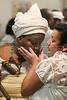 "A woman worships a mother-of-saint during a Candomble ceremony in Rio de Janeiro's working-class district of Bangu, July 24, 2005. Derived from the Yoruba people of West Africa, who were brought to the New World during the African Slave Trade, Candomble seeks harmony with nature. In fact, many Yoruba priests chose to be captured and sold into slavery so that Africans would have spiritual support in the New World. Candomble worships a number of gods or spirits, derived from African deities, known as Orix‡s. An Orixa is a spirit that reflects one of the manifestations of Olodumare (God). Orixas include Shango, Olokun, Elegua, If‡, Osun, Obatala, Ogun, Oko, Soponna, Oya and Esu, among countless others. Over the centuries Candomble has also incorporated many elements from Christianity and African deities were often identified with specific Catholic saints, in part to mask the illegal religion. In the ceremony, led by the mother-of-saint, each child-of-saint (medianic priest) invokes and ""incorporates"" an Orixa, falling into a trance-like state. After recovering from the trance, the priest-spirit performs a dance symbolic of the Orix‡'s attributes, while the father-of-saint (leading male priest) sings about the spirit's deeds.(Australfoto/Douglas Engle)"
