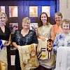 (L-R) Allison Whitfield, Marilyn Hough, Lindsay Hough, Jody Perkins and Doris Cannaday hold their husbands' stoles and chasubles prior to the Mass. Hundreds of people attended the ordination Mass of Mark Cannaday, Charles Hough III, Charles Hough IV, Timothy Perkins, Christopher Stainbrook, and Joshua Whitfield to the Personal Ordinariate of the Chair of St. Peter. (Special/ Juan Guajardo)