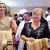 Lindsay Hough (left), wife of Fr. Charles Hough IV, and Marilyn Hough, wife of Fr. Charles Hough III, hold their husbands' vestments before processing into the church. Hundreds of people attended the ordination Mass of Mark Cannaday, Charles Hough III, Charles Hough IV, Timothy Perkins, Christopher Stainbrook, and Joshua Whitfield to the Personal Ordinariate of the Chair of St. Peter. (Special/ Juan Guajardo)
