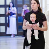 Julie Heinen kneels with her 4-month-old daughter, Gemma, as she participates in the Litany of Saints. Heinen is from St. Mary the Virgin in Arlington. Hundreds of people attended the ordination Mass of Mark Cannaday, Charles Hough III, Charles Hough IV, Timothy Perkins, Christopher Stainbrook, and Joshua Whitfield to the Personal Ordinariate of the Chair of St. Peter. (Special/ Juan Guajardo)