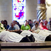 The six ordained men lie prostrate before the altar during the Litany of Saints. Hundreds of people attended the ordination Mass of Mark Cannaday, Charles Hough III, Charles Hough IV, Timothy Perkins, Christopher Stainbrook, and Joshua Whitfield to the Personal Ordinariate of the Chair of St. Peter. (Special/ Juan Guajardo)