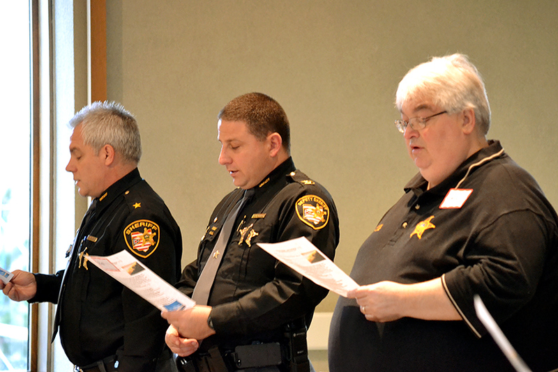 From left, Montomery County, Ohio, Sheriff Phil Plummer, Chief Deputy Rob Streck, and chaplain Larry Lane attend a memorial prayer service Jan. 12 at Salem Heights for those killed by violence in Dayton, Trotwood and Harrsion Township last year.