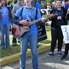 Harrison Lewis, a college student who remains involved in youth ministry in the Diocese of Fort Worth, entertains as marchers gather for the 2015 Texas Rally for Life in Austin.