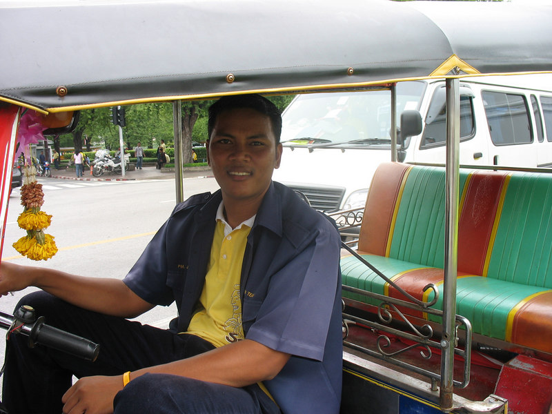 Sam with his tuk-tuk.