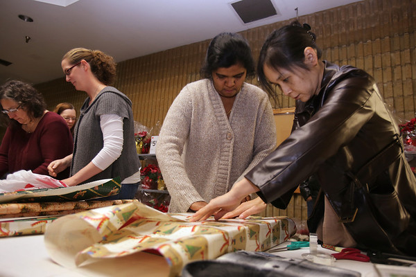 Baptist Church volunteers wrap Christmas presents at Billerica K-Mart