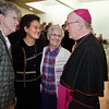 Sr. Clara Vo (center) and Sr. Patricia Ste. Marie (right), both Sisters of St. Mary Namur, say goodbye to Bishop Vann. Hundreds of parishioners and friends of Bishop Kevin Vann came out to attend a Vespers service and to say goodbye to the bishop at Our Lady Queen of Peace Parish in Wichita Falls on November 26, 2012.