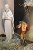 Below the interior crib scene and statue of Virgin Mary and a shepherd.