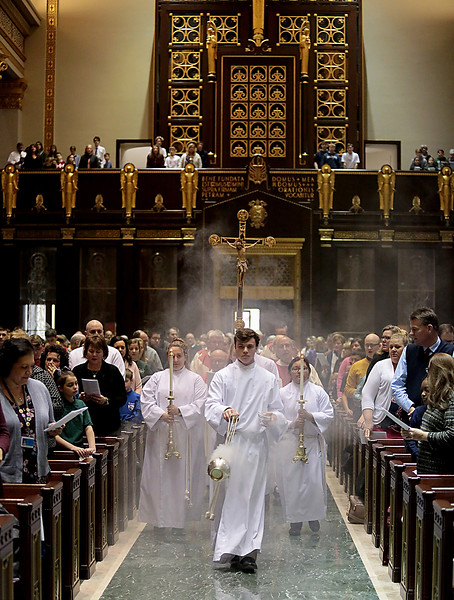 Thurifer Jesse Hardin, from Moeller, leads the Procession during the Catholic Schools Week Mass at the Cathedral of Saint Peter in Chains in Cincinnati Tuesday, Jan. 29, 2019. (CT Photo/E.L. Hubbard)