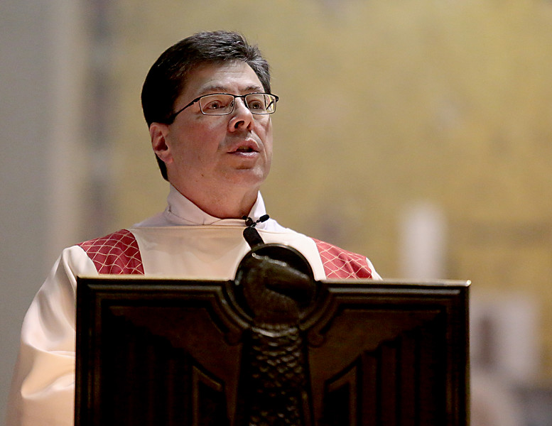 Deacon Mark Machuga proclaims the Gospel during the Catholic Schools Week Mass at the Cathedral of Saint Peter in Chains in Cincinnati Tuesday, Jan. 29, 2019. (CT Photo/E.L. Hubbard)