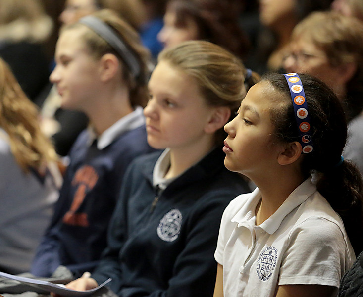Students listen to the Homily of Bishop Joseph Binzer during the Catholic Schools Week Mass at the Cathedral of Saint Peter in Chains in Cincinnati Tuesday, Jan. 29, 2019. (CT Photo/E.L. Hubbard)