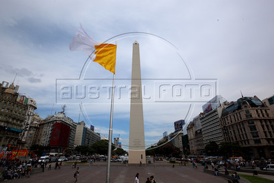 The Vatican flag flies over downtown Buenos Aires, Argentina, next to the landmark Obelisk, on the day after the Jorge Bergoglio was chosen as sucessor to Pope Benedict XVI. Bergoglio is now called Pope Francisco. (Australfoto/Douglas Engle)