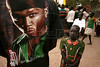 A young girl stands near a man wearing a shirt with American rapper 50 cent on it during mass in Rumbek in southern Sudan to celebrate the 50th anniversary of the Diocese of Rumbek, Nov. 19, 2005. The mass was to welcome Catholic Archbishop of Khartoum, Cardinal Gabriel Zubeir Wako, the first Sudanese cardinal ever, in a celebration seldom seen before the the Jan. 9, 2005 peace accord was signed. The accord ended a 21-year conflict in the largest nation in Africa, which has only known 11 years of peace since independence from Britain in 1956.  In the accord, the Islamic Arab Sudanese government agreed to give autonomy to the non-Muslim southern Sudan region. After a six year period a referendum will be held to decide on independence or rejoining with the central government. The region has a population of around 9 million and a predominantly rural, subsistence economy. More than 2 million people have died and more than 4 million are internally displaced or have become refugees as a result of the civil war and war-related impacts.(Australfoto/Douglas Engle)