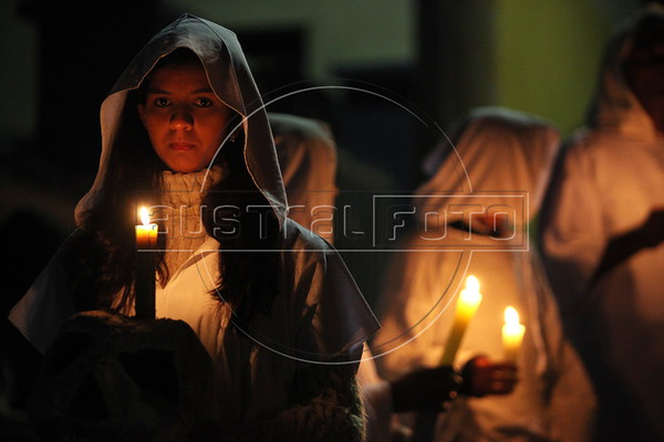 "Dressed in all white and carrying candles and replicas of bones, worshipers participate in the ""Procession of the Souls"" at 11:55 PM on Good Friday in Mariana in the Brazilian state of Minas Gerais. The procession re-enacts a legend of the city: during holy Week, the dead leave the cemetery in procession to the church. (Douglas Engle/Australfoto)"