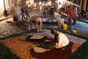 """Worshipers prepare """"carpets"""" made of colored sawdust and rice husks on the streets of the historic city of Ouro Preto in the Brazilian state of Minas Gerais. The """"carpets"""" pave the path were the Easter Sunday procession passes later that day. (Douglas Engle/Australfoto)"""