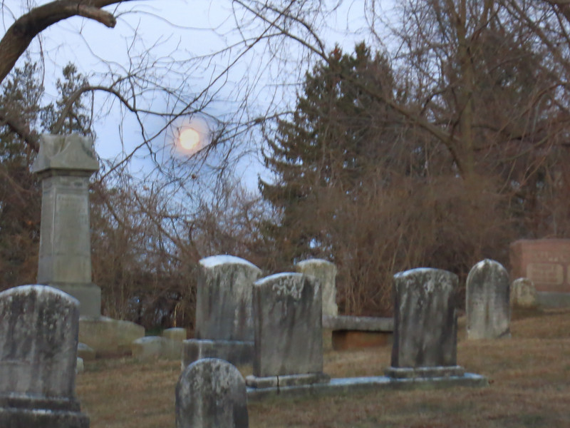 Dawn full moon during early Easter service