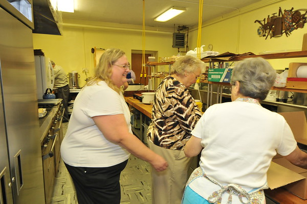 Linda encourages the Kitchen Crew!