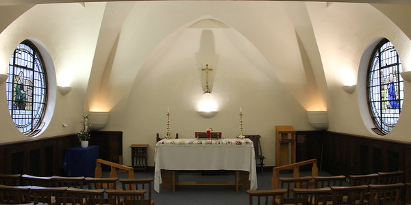 Altar with circular side windows