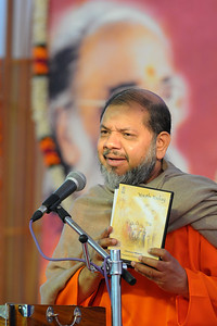 Guruji releasing a set of DVDs which contain talk by Gurudev Swami Chinmayanandaji.  Chinmaya Mission's 25th AICHYK (All India CHYK) Conference, 16th to 18th January 2009 at Chinmaya Vibhooti, Kolwan, Maharashtra, India.
