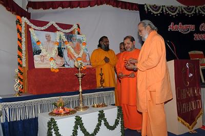 Guruji (Swami Tejomayanandaji) along with Swami Brahmanandaji and Swami Purushottamanandaji lighting the lamp and praying for a successful conference. Chinmaya Mission's Aacharya Conference, July 2008 held at Chinmaya Vibhooti Vision Centre, Kolwan (near Lonavala/Pune), Maharashtra, India.