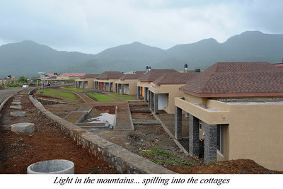 Light in the mountains... spiling into the cottages  Construction going on at Chinmaya Vibhooti. Chinmaya Mission's Aacharya Conference, July 2008 held at Chinmaya Vibhooti Vision Centre, Kolwan (near Lonavala/Pune), Maharashtra, India.