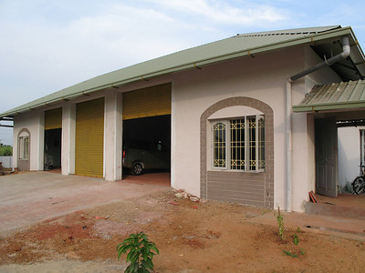 The garage; behind the garage is the residence for the cook and family.