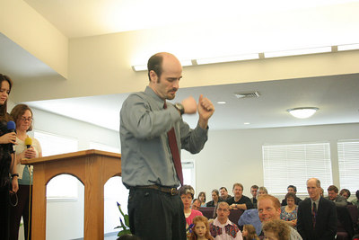 Mike Johnson offering a prayer at a combined service at the Vancouver, Washington, USA, SDA church.